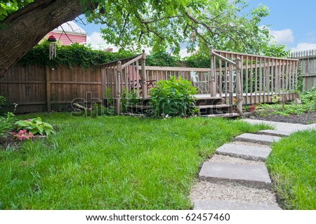 Beautiful outdoor deck seating area in the back yard garden provides restful relaxation and solitude.