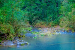 Beautiful outdoor view of gorgeous river of turquoise water located at Pucon, Chile