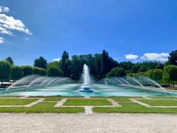 Beautiful outdoor water fountain with dancing waters on a sunny day in Battersea park, London