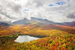 Beautiful overlook of fall colors and pond in New England
