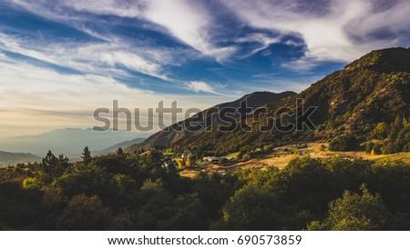 Beautiful overlook of mountain and valley at sunset, Oak Glen, California #690573859