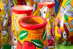 Beautiful painted colorful terracotta pots, works of handicraft, for sale during Handicraft Fair in Kolkata.