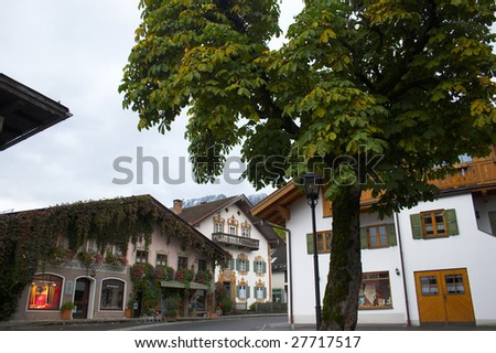 Beautiful painted houses of Oberammergau and tree in Bavaria