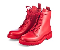 Beautiful pair of high red leather boots on lace and a massive sole with a rough tread, isolated on a white background with a shadow. Trend of the season: brightness and uniqueness of the image.