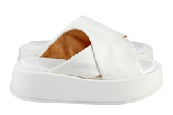 Beautiful pair of snow-white flip-flops made of genuine white leather with criss-cross stripes and a massive high sole. Side view. The trend of the season.