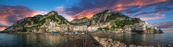 Beautiful panorama of Amalfi, the main town of the coast on which it is located taken from the sea. Situated in province of Salerno, in the region of Campania, Italy, on the Gulf of Salerno at sunset.