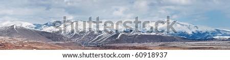 Beautiful panorama of caucasian snowy mountain upland - stock photo