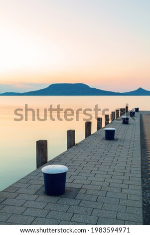 Beautiful panorama of Lake Balaton near the town of Fonyod, in the background the Badacsony Mountains and Szigliget at sunset in Hungary Stock photo ©