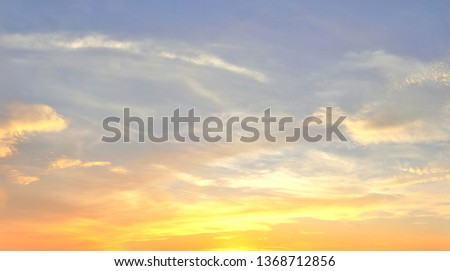 Beautiful panorama of orange and yellow cloudscapes at sunrise/sunset  on a blue sky in high resolution #1368712856