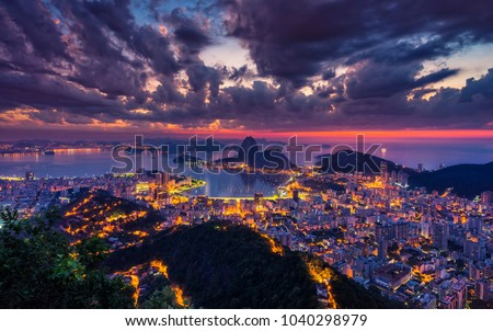 Beautiful panorama of Rio de Janeiro at twilight, Brazil. Sugarloaf Mountain and Botafogo Bay. Ultra violet colors