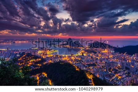 Beautiful panorama of Rio de Janeiro at twilight, Brazil. Sugarloaf Mountain and Botafogo Bay. Ultra violet colors