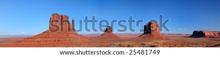beautiful panorama of the monument valley navajo tribal park at Arizona showing the East and West Mittens and the Merrick butte