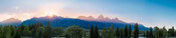 Beautiful panorama of the sunset over the grand tetons mountain range in the grand teton national park in summer at golden hour. Sunset / sunrise over the mountain range