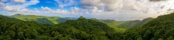 Beautiful panorama of the tropical island forest. Huge hills covered in trees at sunset.