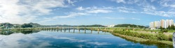 Beautiful panorama view of Andong bridge with  reflection in the water. Andong bridge is the new bridge across the Nakdong River in  Andong city
