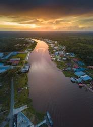 Beautiful panorama view of Dalat river during sunset at Mukah Sarawak Malaysia. Soft focus and noise visible due to long exposure.