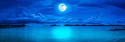 Beautiful panorama view of the sea. Colorful blue sky with cloud and bright full moon on seascape to night. Serenity nature background, outdoor at nighttime. The moon taken with my own camera.