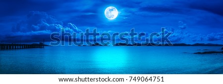 Beautiful panorama view of the sea. Colorful blue sky with cloud and bright full moon on seascape to night. Serenity nature background, outdoor at nighttime. The moon taken with my own camera. #749064751
