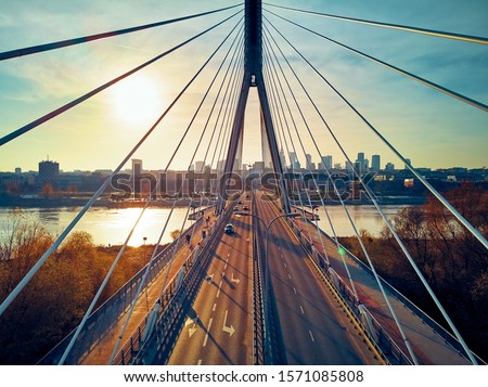 Beautiful panoramic aerial drone sunset view to Warsaw city center with skyscrapers and Swietokrzyski Bridge (En: Holy Cross Bridge) - is a cable-stayed bridge over the Vistula river in Warsaw, Poland