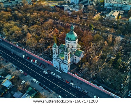 Beautiful panoramic aerial drone view to the ?enter of modern Warsaw city with silhouettes of skyscrapers and Church Karol Boromeusz (at the Powazki Cemetery) in amazing winter January sunset, Poland stock photo