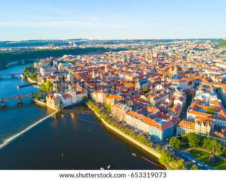 Beautiful panoramic aerial sunrise view of the Prague city from above with the old town and Vltava river. Amazing city landscape footage.  #653319073