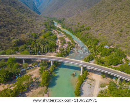 beautiful panoramic aerial view of a beautiful natural river of clear water in the Sierra Gorda of Queretaro called Juntas Del Conca #1136320991