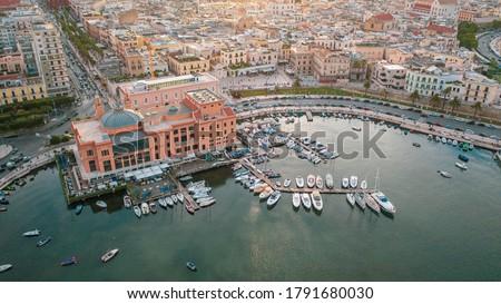 Beautiful panoramic aerial view photo from flying drone at sunset to Bari Apulia City port boats and yachts Sea Coastline, Teatro Margherita, and Bari city skyline. Bari ,Apulia, Italy (Series) Foto stock ©