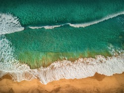 Beautiful panoramic birds eye view on ocean waves, Fuerteventura island. Aerial shooting seascape coastline at sunny day. Travell, Beach,islands, Nature, freedom concept.
