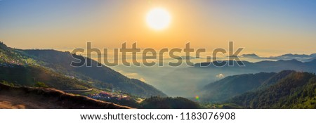 Photo of  Beautiful panoramic landscape above clouds and mountains with sun rising in the middle.