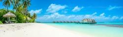 Beautiful panoramic landscape of over water villas, Maldives island, Indian Ocean