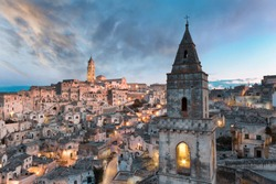 Beautiful panoramic landscape of the little town of Matera (Sassi di Matera) during a stunning golden hour sunset. the ancient village of Matera in Basilicata, southern Italy