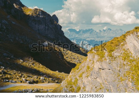 Beautiful panoramic nature in the mountains, the miracle of nature. Autumn mood at sunset in Switzerland mountains Pizol, Europe #1225983850