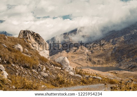 Beautiful panoramic nature in the mountains, the miracle of nature. Mountain Pass in Switzerland. Autumn mood at sunset. #1225954234