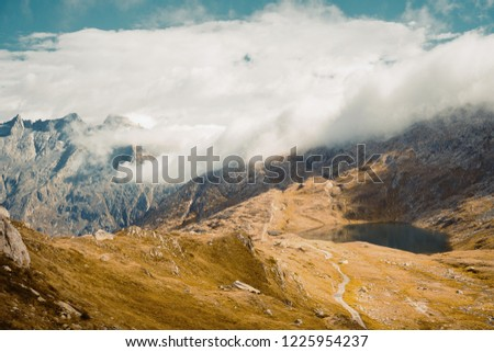 Beautiful panoramic nature in the mountains, the miracle of nature. Mountain Pass in Switzerland. Autumn mood at sunset. #1225954237