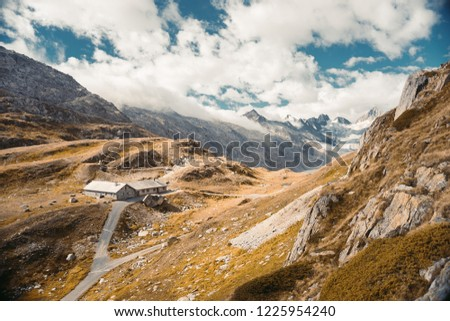 Beautiful panoramic nature in the mountains, the miracle of nature. Mountain Pass in Switzerland. Autumn mood at sunset. #1225954240