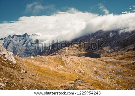Beautiful panoramic nature in the mountains, the miracle of nature. Mountain Pass in Switzerland. Autumn mood at sunset. #1225954243