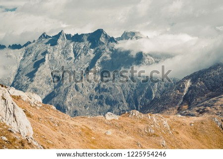 Beautiful panoramic nature in the mountains, the miracle of nature. Mountain Pass in Switzerland. Autumn mood at sunset. #1225954246