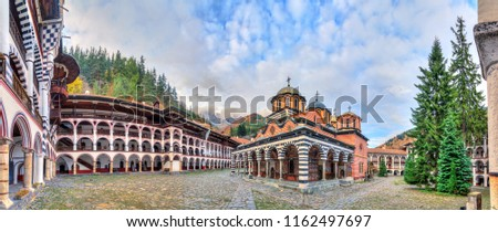 Beautiful panoramic panorama of the Orthodox Rila Monastery, a famous tourist attraction and cultural heritage monument in the Rila Nature Park mountains in Bulgaria - Shutterstock ID 1162497697