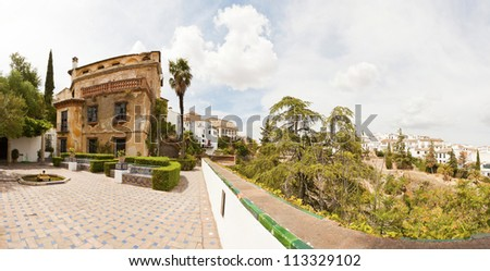 Beautiful panoramic photo of the house of the Moorish king. Casa del Rey Moro. Spanish city Ronda. Malaga. Andalusia. Spain. - stock photo