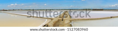 Beautiful panoramic scenery of salt pan at Samutsongkram province during summer time of Thailand,  South East Asia, Asia.