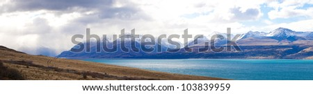 Beautiful panoramic scenery of Tasman valleys and Tasman turquoise color lake Aoraki Mt Cook national park Southern Alps mountain South Island New Zealand - stock photo