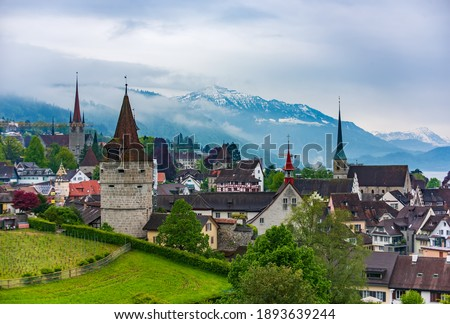 Beautiful panoramic top view of the old town of Zug, Switzerland with historical turrets and towers and famous Rigi mountain on background Stock fotó ©