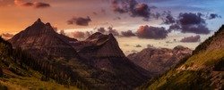 Beautiful Panoramic View of American Rockies from a viewpoint. Dramatic Sunset Sky Art Render. Taken in Glacier National Park, Montana, United States of America.