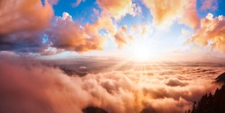 Beautiful Panoramic View of Canadian Mountain Landscape covered in clouds during a vibrant summer sunset. Dramatic Sky Artistic Render. St Mark's Summit, West Vancouver, British Columbia, Canada.