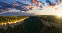 Beautiful Panoramic View of Canadian Nature and a Rocky Canyon, surrounded by cliffs, trees. Aerial Shot, scenic valley. Thompson-Nicola region, south of 70 Mile House, Interior British Columbia.
