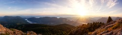 Beautiful Panoramic View of Canadian Nature Landscape from the top of Tin Hat Mountain during a sunny summer sunset. Taken near Powell River, Sunshine Coast, British Columbia, Canada.