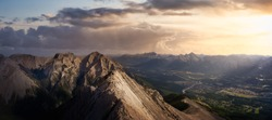 Beautiful Panoramic View of Canadian Rocky Mountain Landscape. Dramatic Colorful Sunset Sky Art Render. Taken from Mt Lady MacDonald, Canmore, Alberta, Canada.