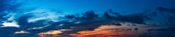 Beautiful Panoramic View of Cloudscape during a colorful sunset or sunrise. Taken on the East Coast by the Atlantic Ocean in Canada.