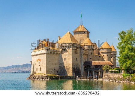 Beautiful Panoramic View of Famous Chateau de Chillon at Lake Geneva, one of Switzerland's Tourist Attractions and Most visited Castles in Europe with Blue Sky and Clouds, Canton of Vaud, Switzerland #636290432