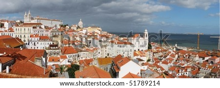 beautiful panoramic view of Lisbon (left to right landmarks: Sao Vicente de Fora church, Pantheon or Santa Engracia church, Santo Estevao church)